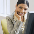Indian businesswoman looking at computer — Stock Photo