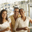 Friends smiling on marina balcony — Stock Photo
