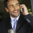 South American businessman talking on cell phone — Stock Photo