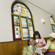 African American reading in church - 图库照片