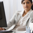Stock Photo: Indibusinesswomsitting at desk