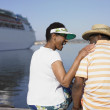 Senior African couple and cruise ship in background — Stock Photo