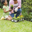African mother and daughter gardening — Stock Photo