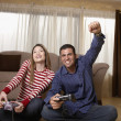 Hispanic couple playing video game — Stock Photo #23275054