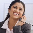 Stock Photo: Indibusinesswomtalking on telephone