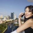 Hispanic woman talking on cell phone — Foto de Stock