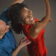 Multi-ethnic couple dancing — Stock Photo