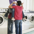 Asian couple in laundromat — Stock Photo