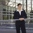 Stock Photo: Businesswomleaning on railing