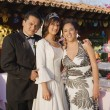 Hispanic girl with parents at Quinceanera — Foto de Stock