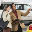 Hispanic couple at car dealership — Stock Photo