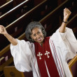 African American female Reverend cheering - Stock fotografie