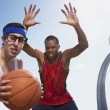 Nerdy man playing basketball with athlete — Stock Photo