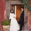 Hispanic girl in Quinceanera dress with chamberlain — Stock Photo