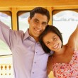 Young couple standing on trolley car — Stock Photo