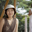 Asian woman wearing safari hat — Stock Photo