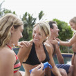 Family applying sunscreen next to swimming pool — Stock Photo