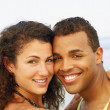 Hispanic couple hugging at beach — Stock Photo