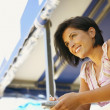 Woman leaning on balcony — Stock Photo