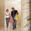 Hispanic couple carrying shopping bags — Stock Photo