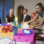 Hispanic girl celebrating birthday with family — Stock Photo #23276044