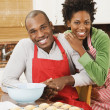 African American couple baking in kitchen — Stock Photo
