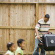 African father cooking on barbeque grill — Stock Photo