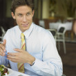 Businessman eating at restaurant — Stock Photo