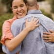 Hispanic couple hugging — 图库照片