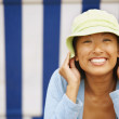 Asiwomwearing sun hat — Stock Photo #23276220