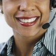 Stock Photo: Africbusinesswomwearing headset