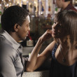 Stock Photo: Africcouple talking at bar