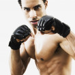 Mixed Race man in boxing stance — Stock Photo