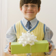 Greek boy holding gift — Stock Photo