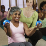 Multi-ethnic women in exercise class — Stock Photo #23276608