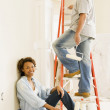African couple painting indoors — Foto Stock