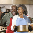 Stock Photo: Senior Africcouple cooking