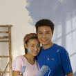 Asian couple painting interior of house — 图库照片