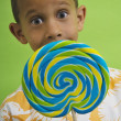 African boy holding big lollipop — Stock Photo