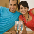 Couple and champagne in new house — Stock Photo