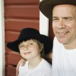Father and son wearing cowboy hats — Stock Photo #23276886