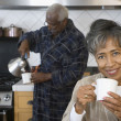 Senior African couple drinking coffee — Stock Photo #23276906