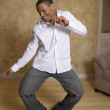 African man dancing in livingroom — Stock Photo