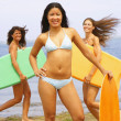 Young women holding boogie boards — Stock Photo