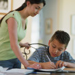 Sister helping brother with homework — Stock Photo