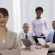 Indian businesswoman with co-workers in background — Stock Photo