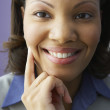 Stock Photo: Close up of Africbusinesswomsmiling