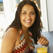 Hispanic woman drinking at bar — Stock Photo
