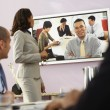 Foto Stock: Multi-ethnic businesspeople having video conference