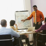 African businessman giving presentation — Stock Photo